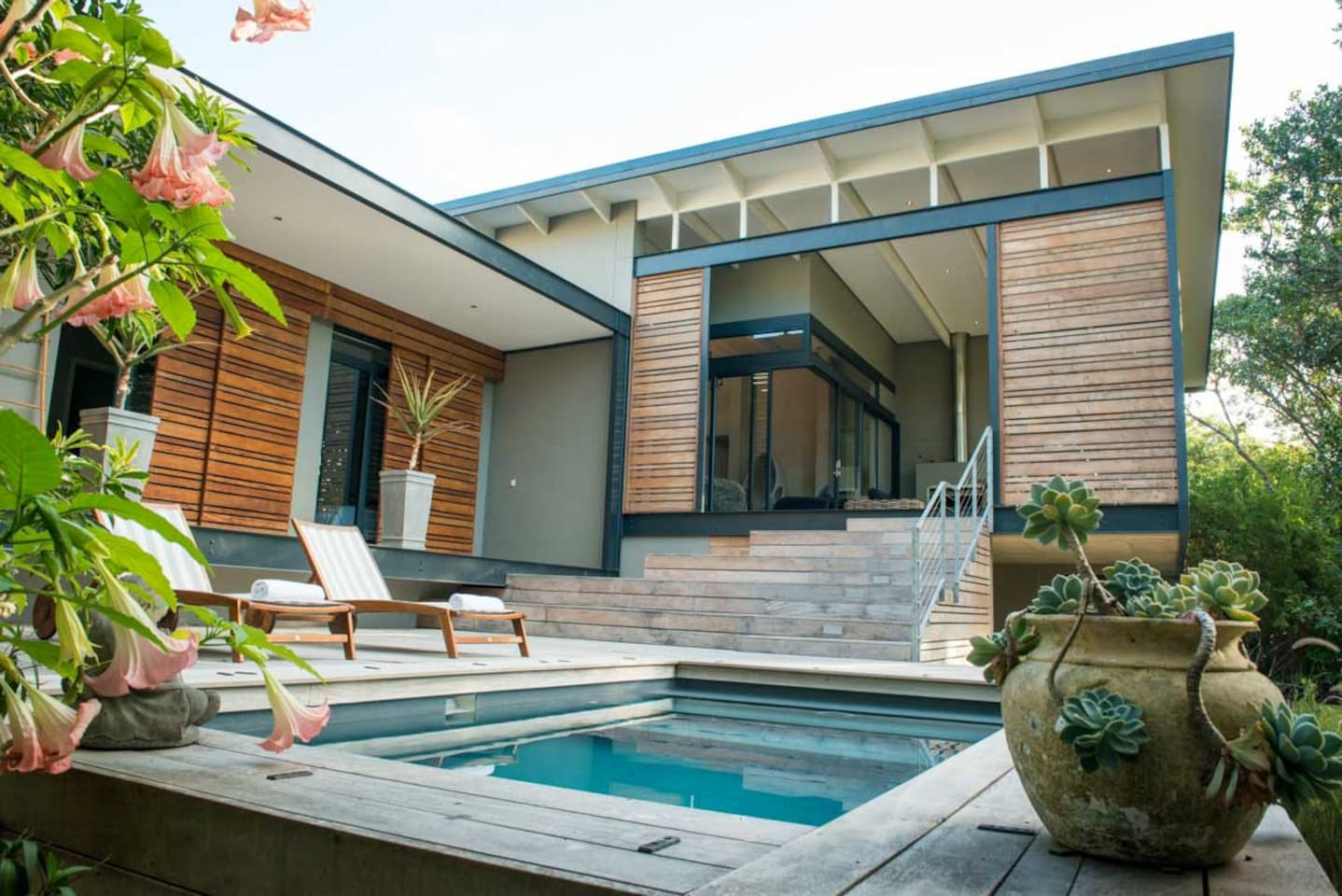 Deck with pool leading up to the lifestyle patio