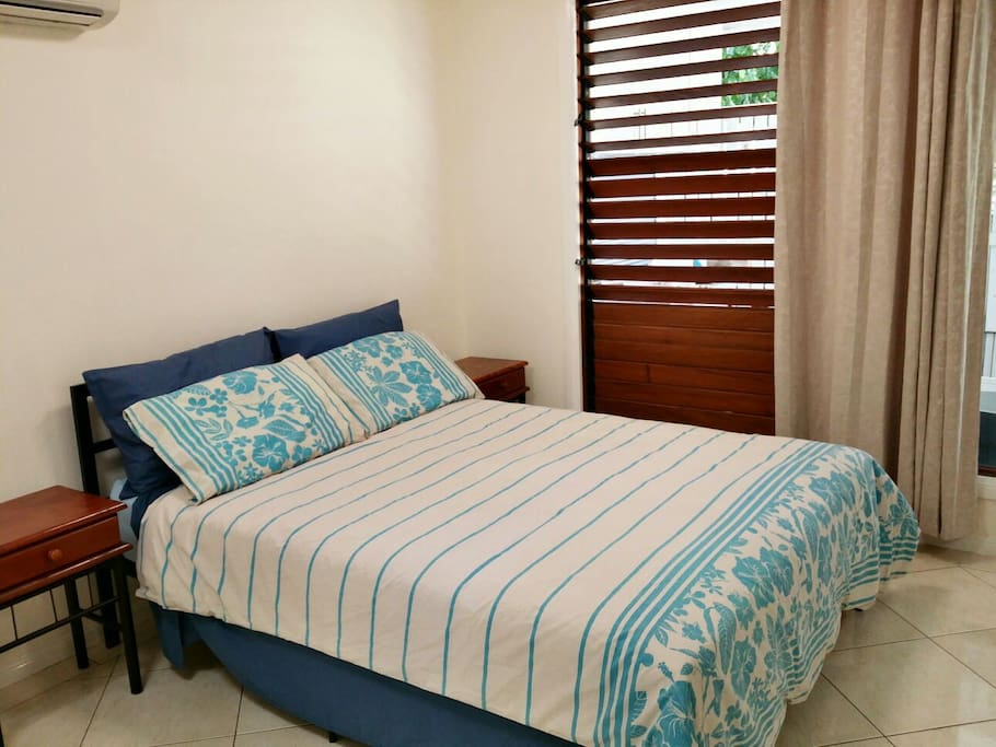 Comfortable double bed in a spacious bedroom with own bathroom