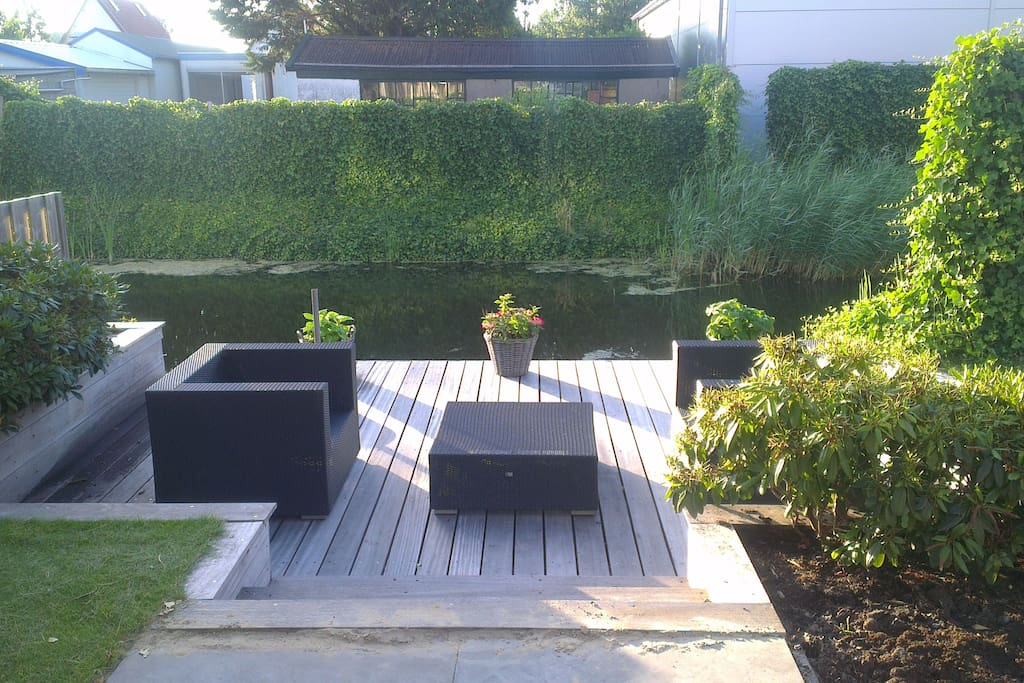 Our nice wooden terrace next to the water for a relaxed moment. We also have a big umbrella.
