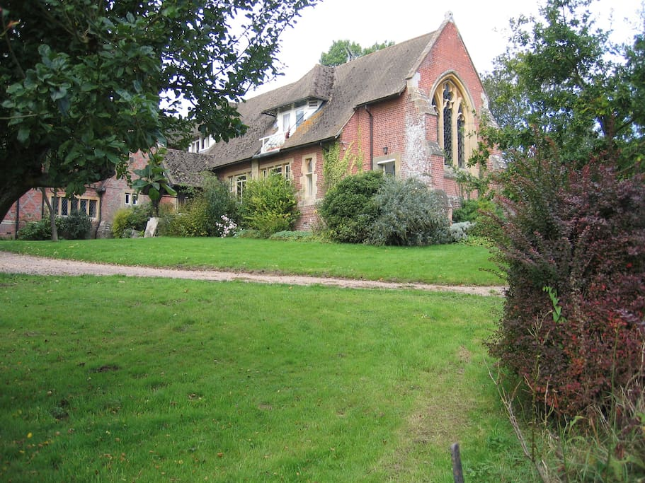 The house is surrounded by fields and woodland, all owned by the villagers themselves
