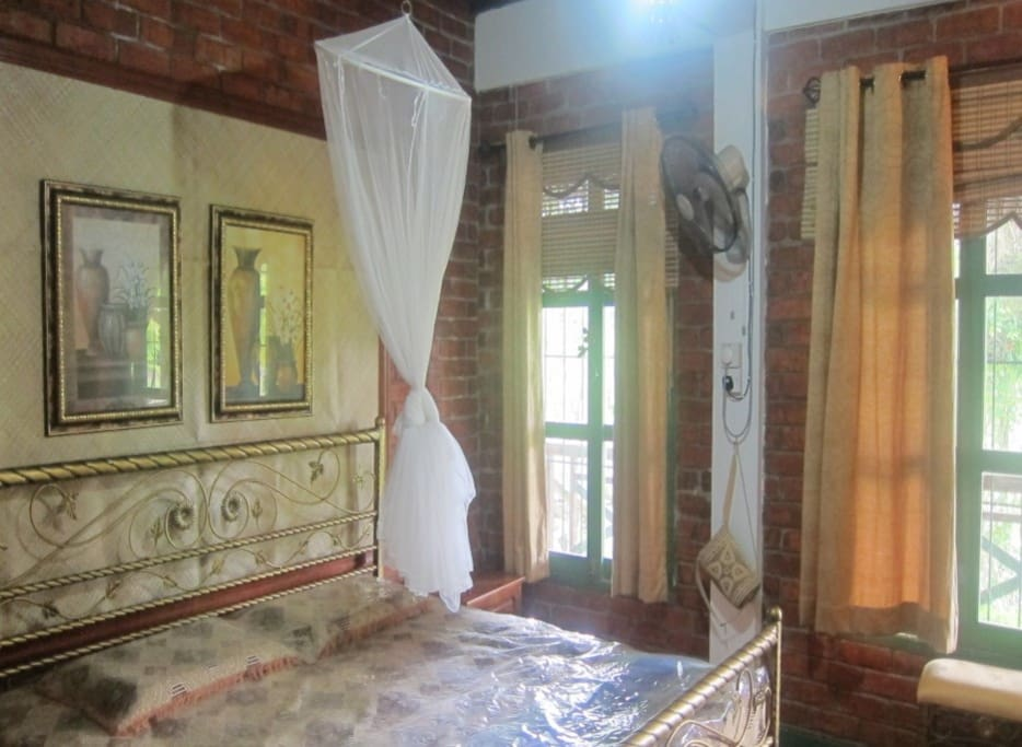 master bedroom air conditioned with attached toilet & bath with hot water