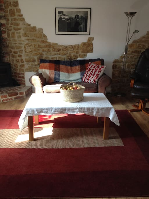 Cosy sitting room with wood burning stove, and a basket of logs for your stay.  30 inch digital TV, classic DVDs, and board games for your entertainment.