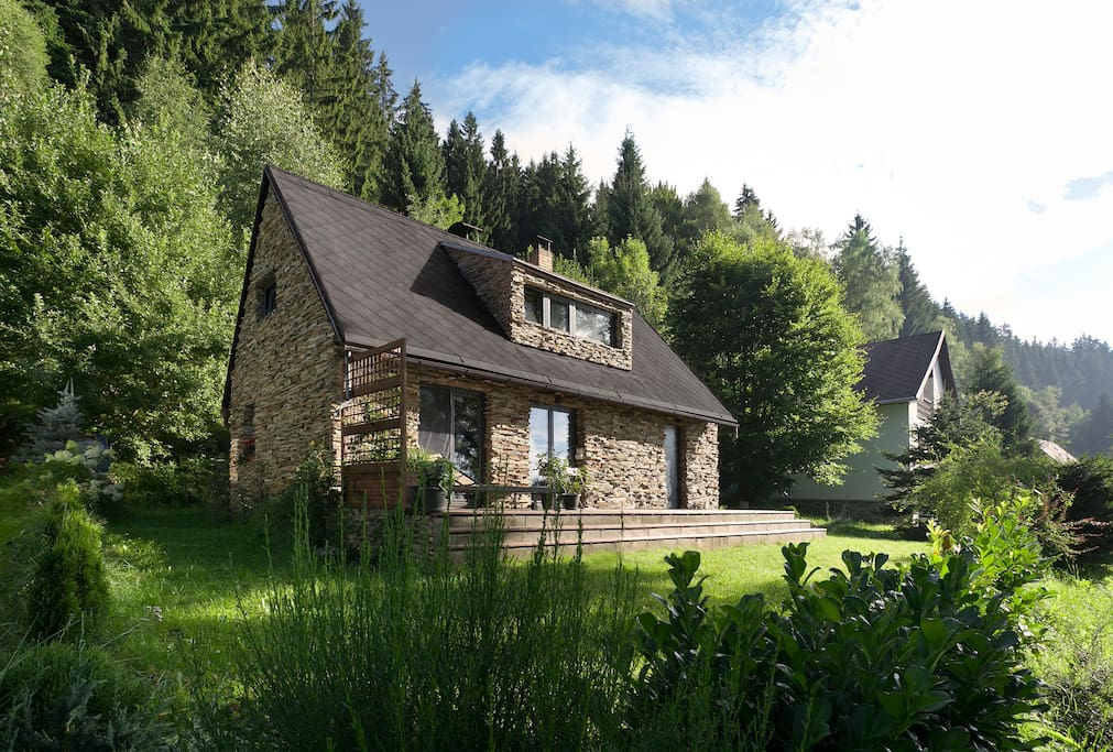 Chalet with Sumava forest behind.