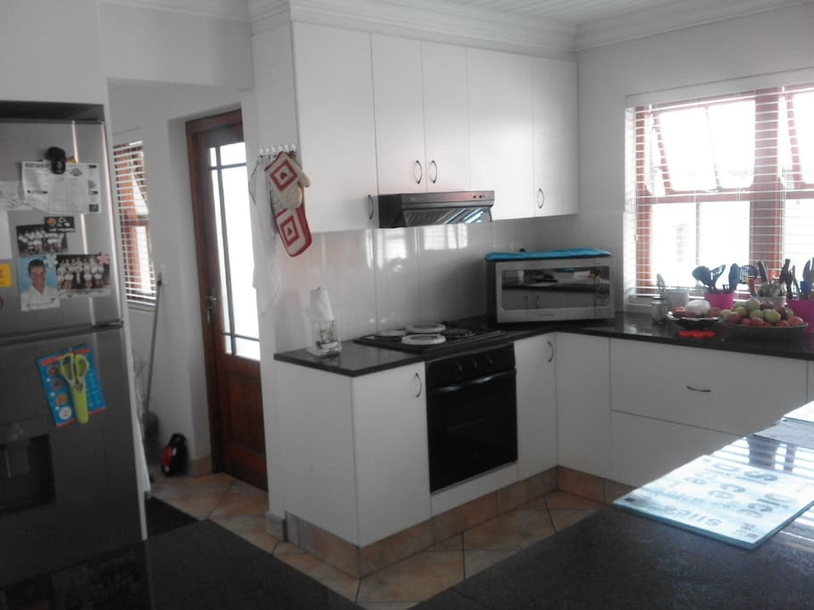 Open lounge kitchen area with scullery