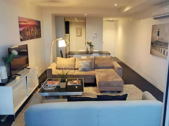 Cozy living room with modern furniture, plenty of seating, TV and more!