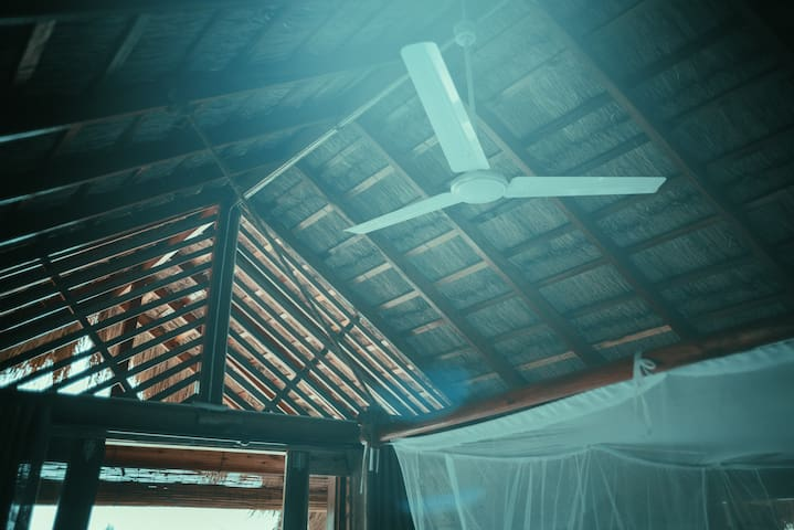 Grass roof is a perfect protection from the heat and allows room to breathe. Each upper cabana has a ceiling fan to cool you down