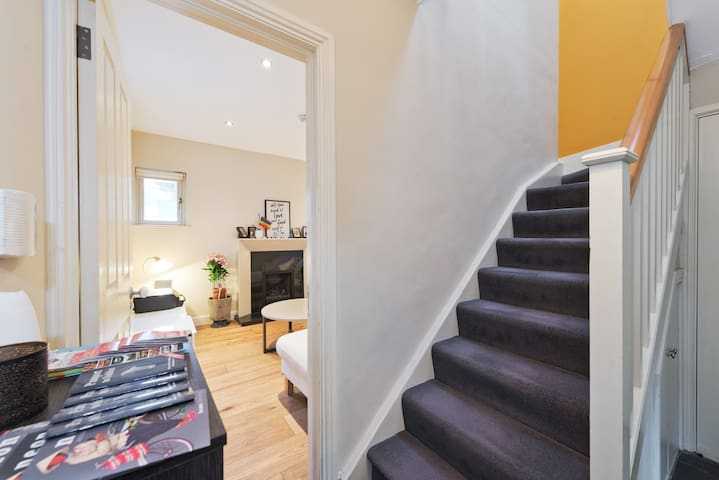 The staircase leading up to your room. Our hallway table always has free maps and guides for Dublin