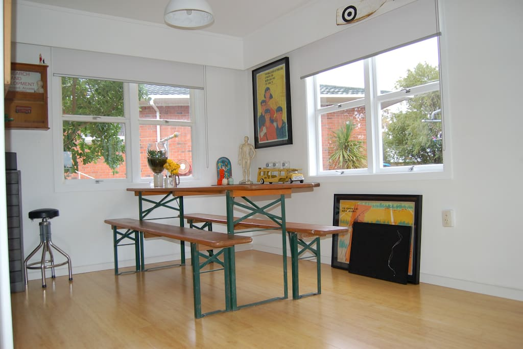 Spacious dining area with large dining table, open to the new kitchen.