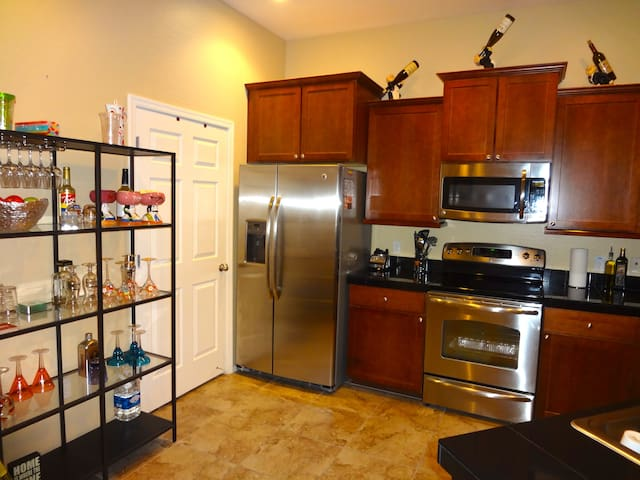 Kitchen with 6 stainless appliances and granite counter tops.