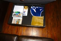 Storage in the 2 ottomans, blankets, info pkgs, office supplies