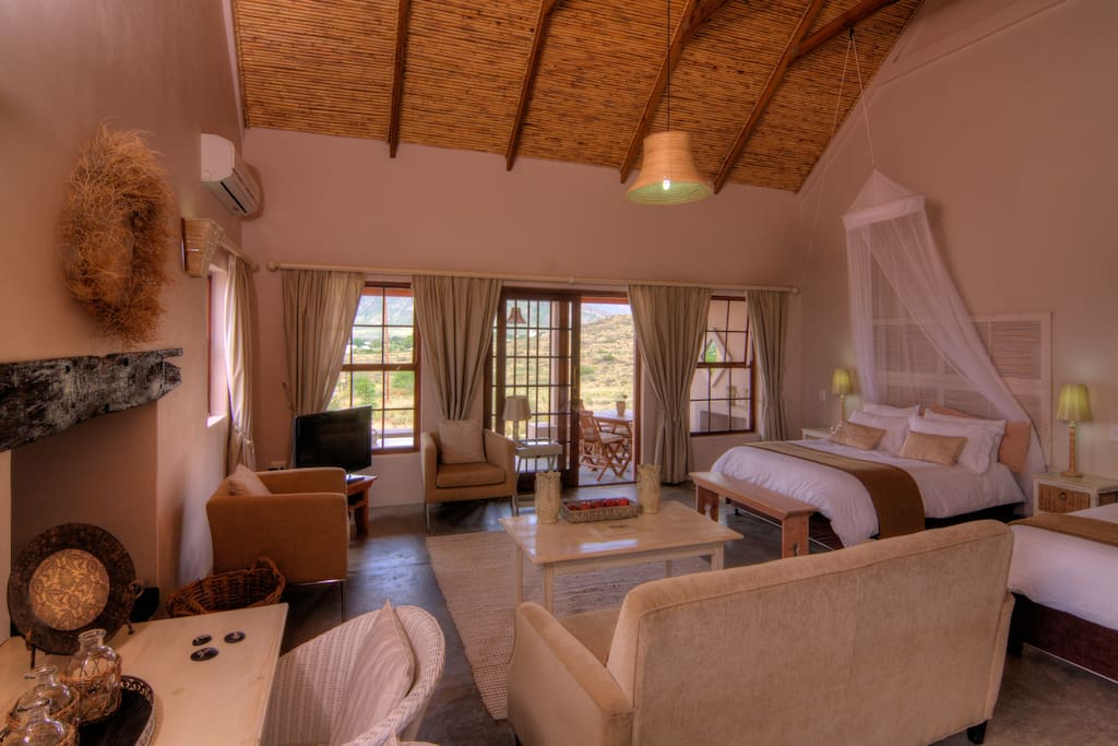 All 4 Cottages at Karoo View are spacious with Log fireplaces & Air Conditioners