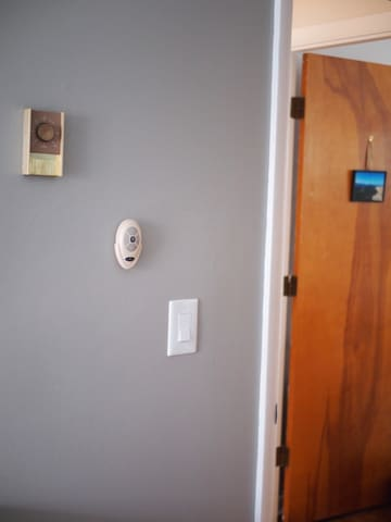 The switches next to the door, the remote controls the room's light and fan. Just make sure the light switch is on!