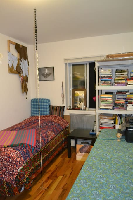 my room with bed and book shelves