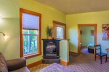 An electric fireplace keeps things cozy in this charming and recently renovated cottage.