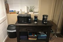 Coffee and tea station, microwave and mini-fridge with freezer compartment for your convenience