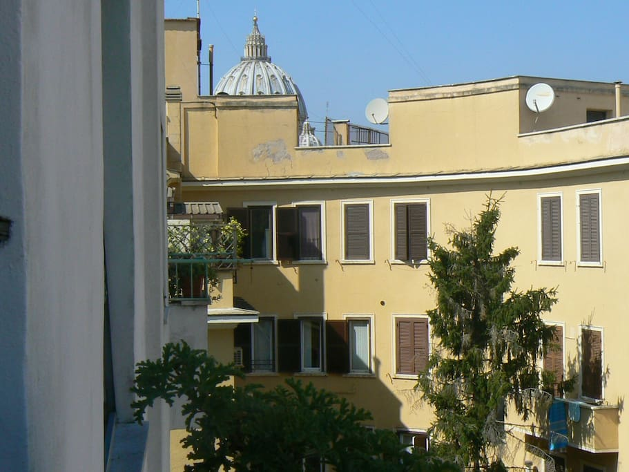 outdoor terrace with panoramic views of the dome of St. Peter