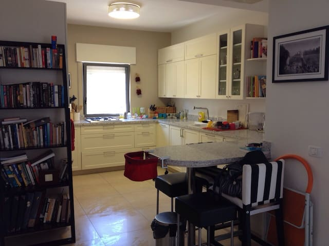 Open kitchen with bar, including stove, oven, microwave, dishwasher, refrigerator