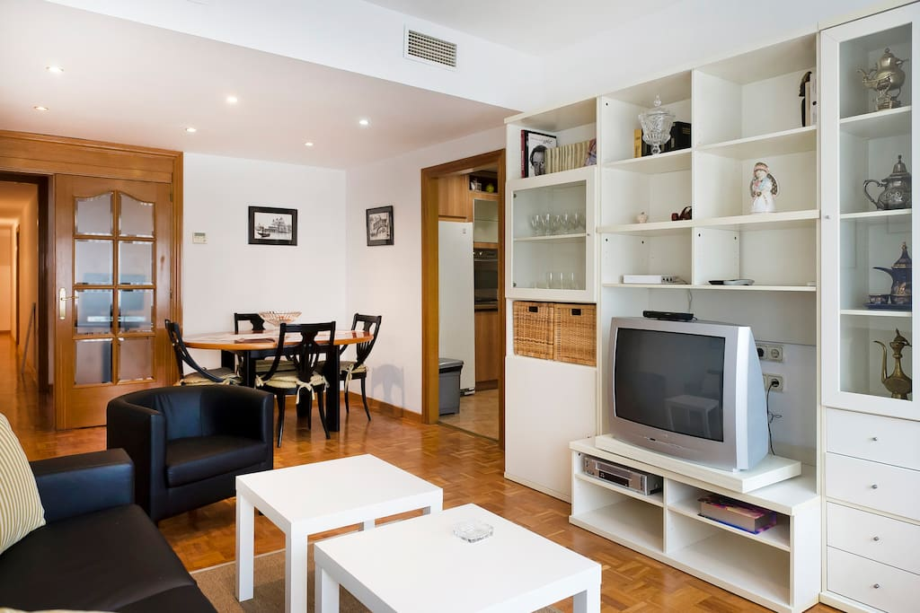 A view of the Living room  combine with dinning and TV shelve / decorations