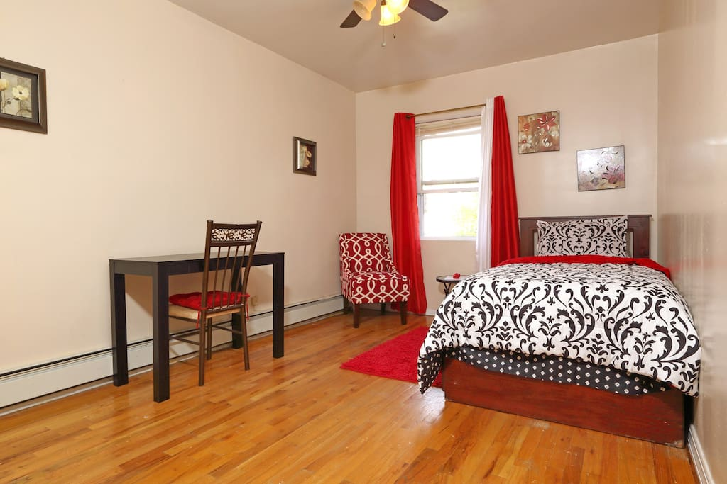wow!  what a clean bright sunny room with a FULL SIZE BED Located at the back of the house for quietness and privacy.