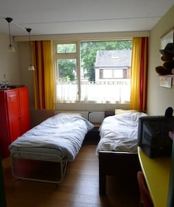 Bedroom with separate sitting room. - Tilburg