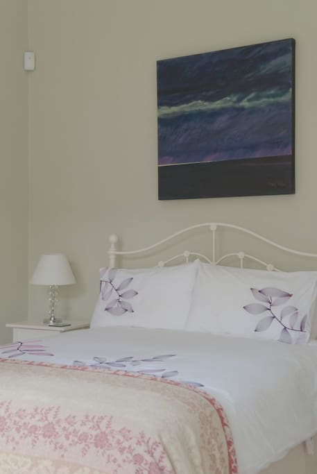 The bedroom features a double bed.