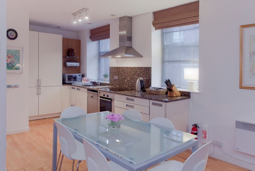 The open plan kitchen and dining/ living room