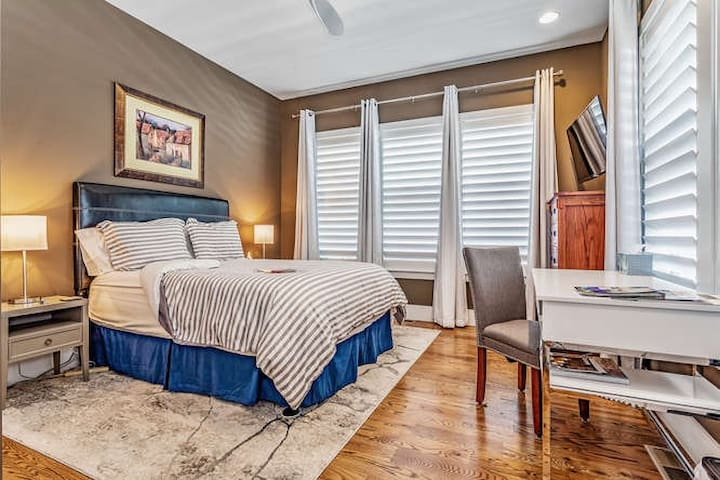 Our guests have said this bed is like sleeping on a cloud. Room includes black out drapes for a great night's sleep and stand up desk in case you need to work during your stay.