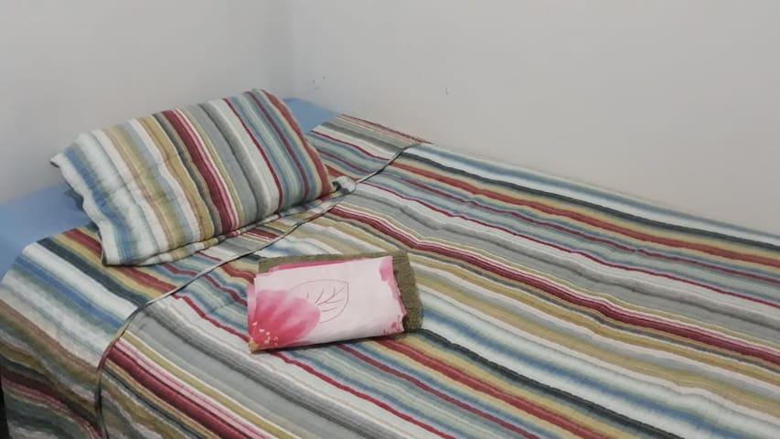 Roupa de cama e travesseiros