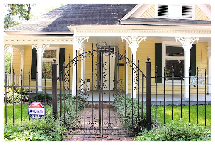 Ornate wrought iron gate and brick walkway