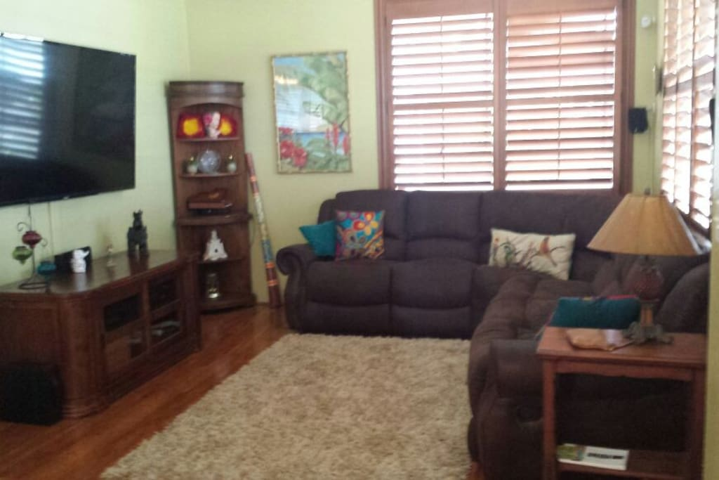 Living room with 80 TV for your comfort