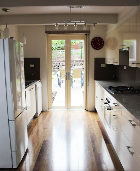 Galley Kitchen with french doors to Patio