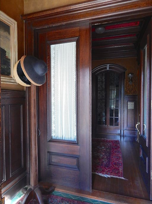 You will enter the house through the front double doors into a grand parlor.