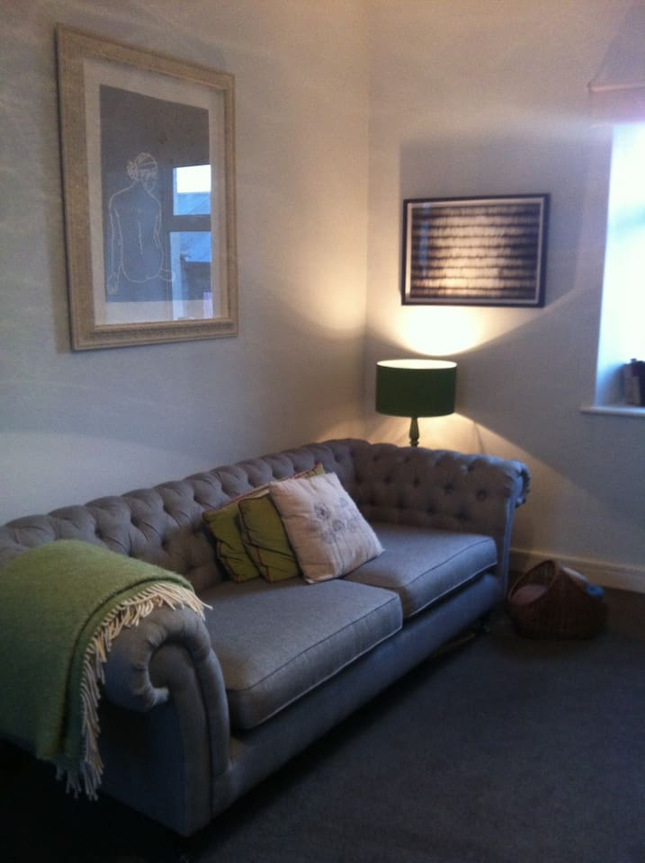 Our sitting room has an open fire (photo to follow!) and a large sofa with other chairs around the room.