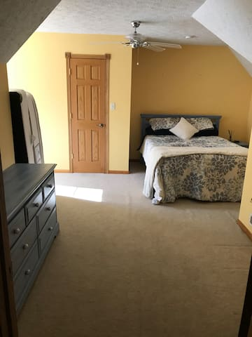 Bedroom with a queen size bed and closet.  there is also a space to the left that can fit a queen size air mattress upon request.
