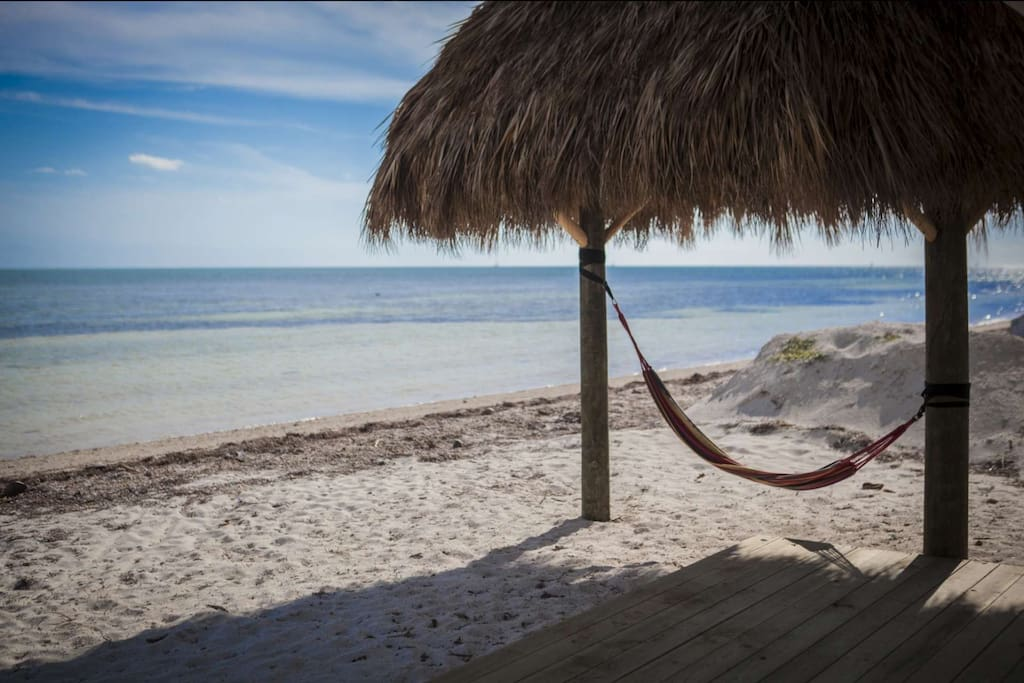 Take a nap in the hammock or relax in the shade under the private tiki hut.