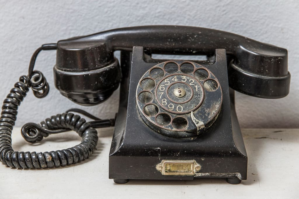 Detail of a antique phone in the living room