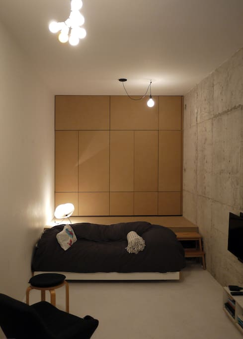 Bed turns into sofa (and hides under the platform), on the back, a large closet space.