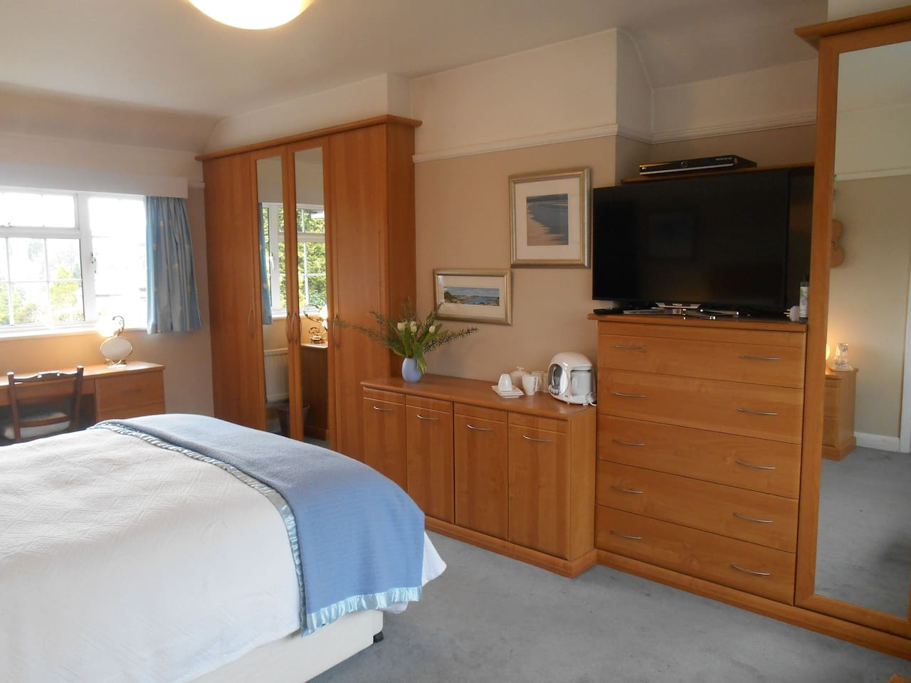 Large, light, dual-aspect double room with large TV