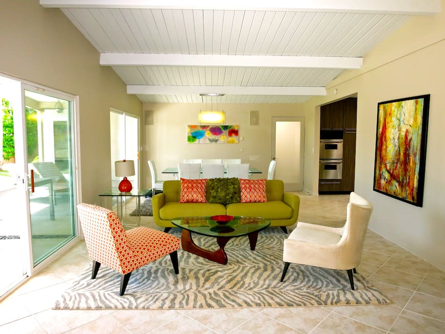 The spacious Conversation Area with gorgeous view of the pool/spa and backyard