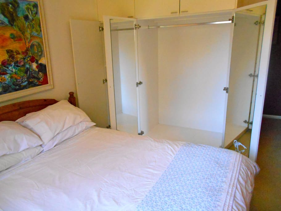 built in wardrobe and drawer space.