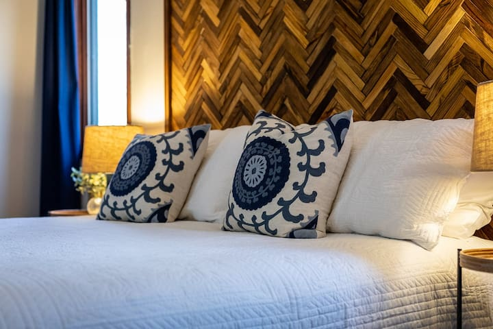 Our Monarch Room features a custom-made wooden headboard and a comfortable King-size bed.