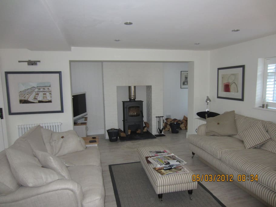 Comfy sofas and a wood burning stove