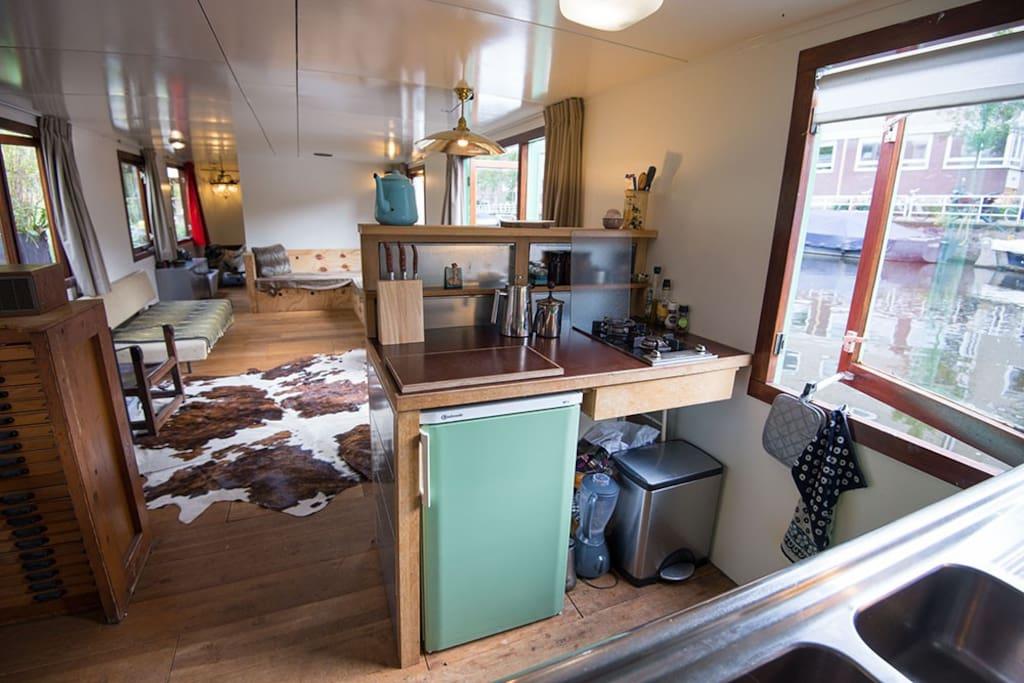 Kitchen; fridge and 2-pits furnace.