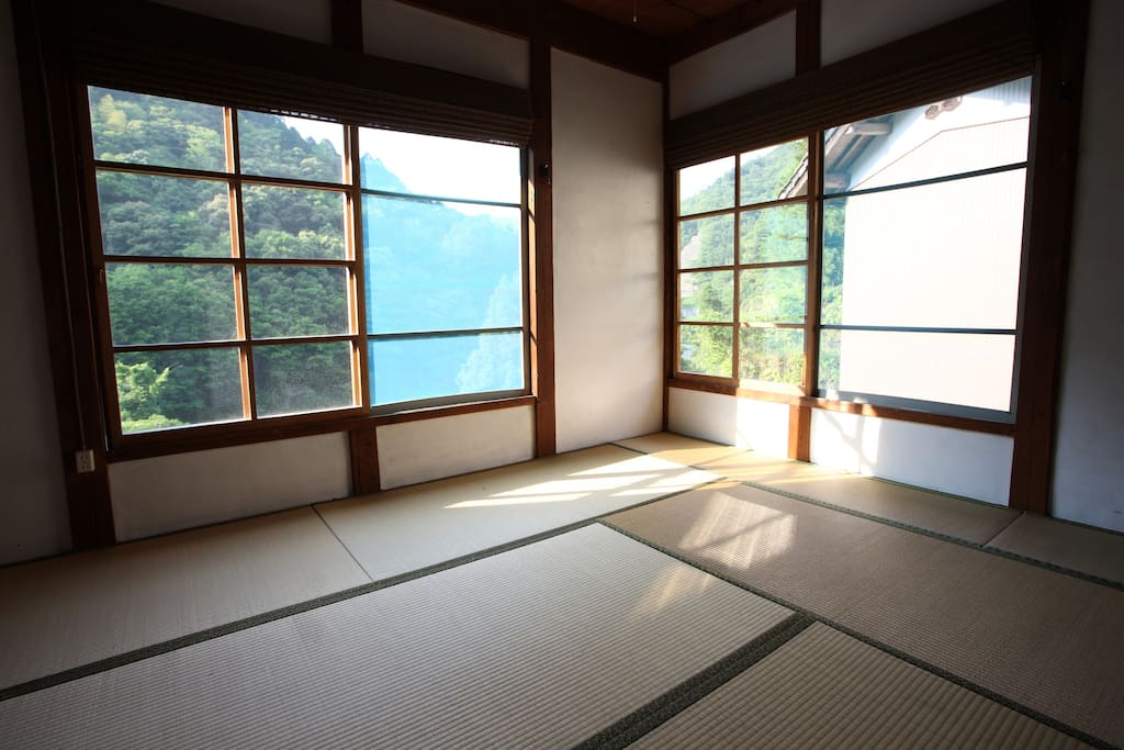 Japanese style room with Tatami flooring and a sliding door.