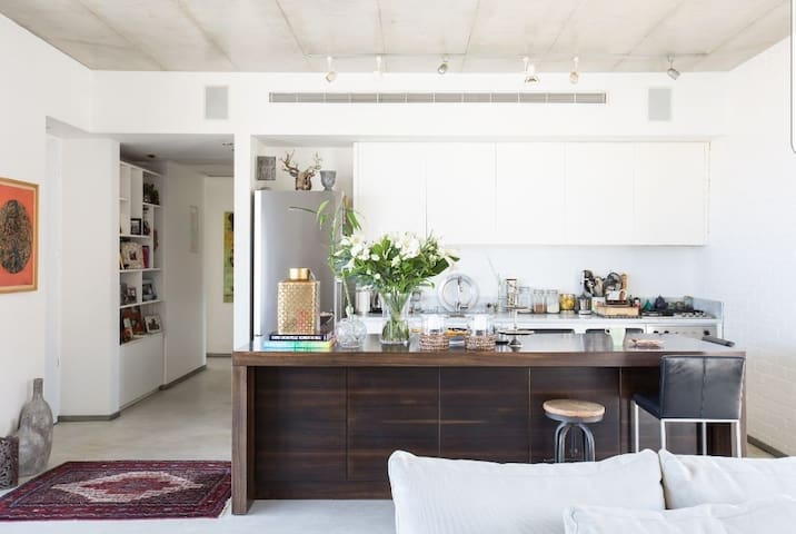 Photographed by Hila Ido. Showing the kitchen.