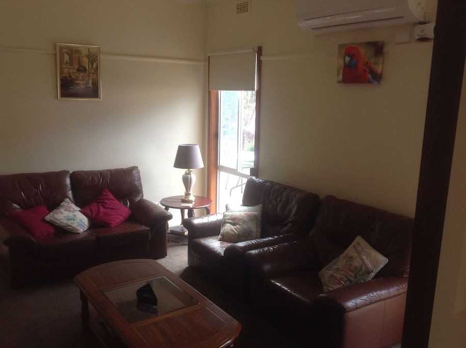 Lounge room with magazines, books, TV and stereo.