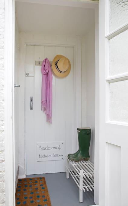 Enter your space via a pretty bootroom/lobby.