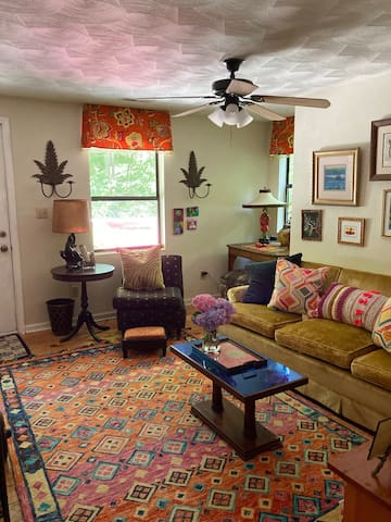 This living room is bright and sunny and lets in lots of light. Flat screen tv.