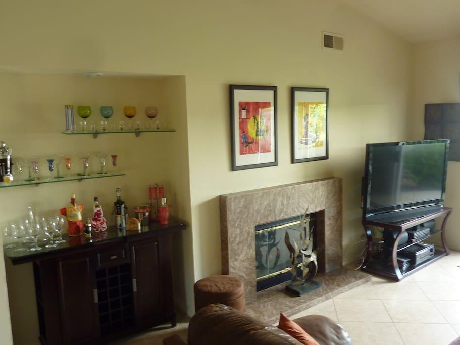 Bar, flat screen TV, Bluray player, surround sound