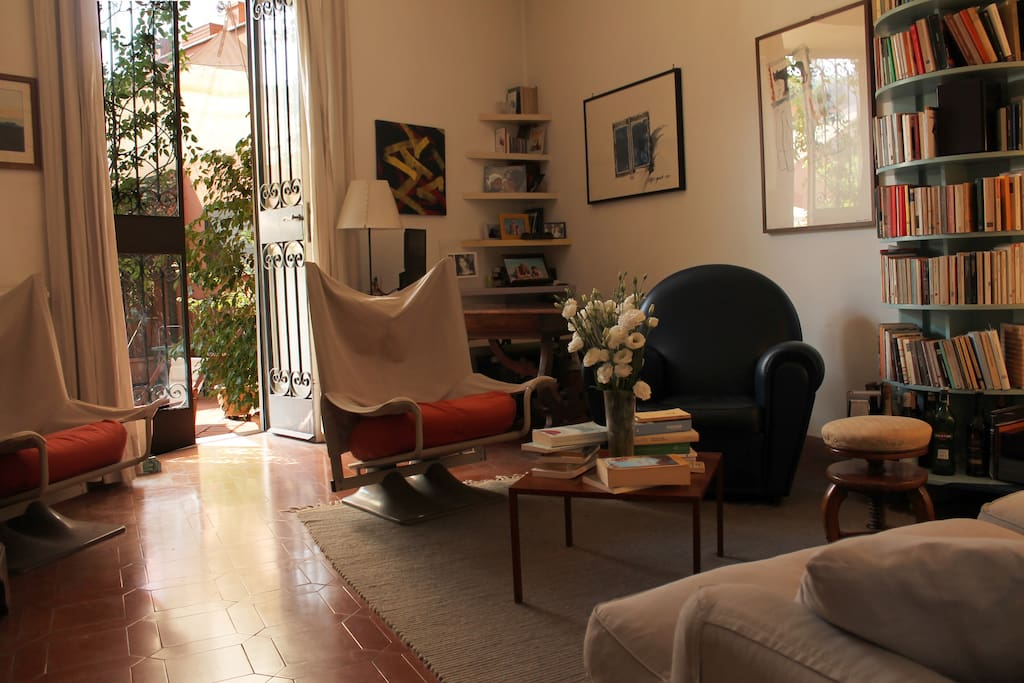 The living room is airy and spacious, opening onto the terrace.